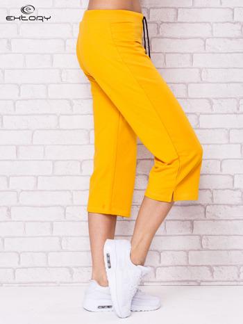 Ciemnożółte spodnie sportowe capri                                  zdj.                                  3