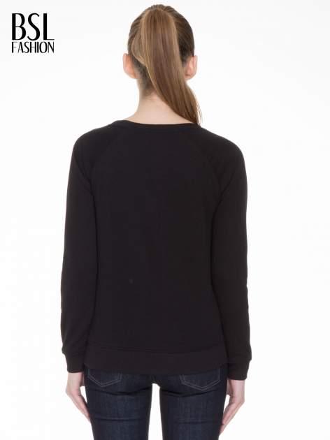 Czarna bluza z reglanowymi rękawami i napisem NYFTW                                  zdj.                                  4