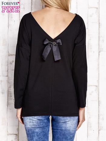 Czarna bluzka z wycięciem na plecach i kokardą                                  zdj.                                  4