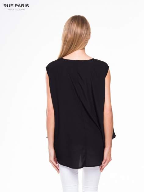 Czarna koszula dzwonek z wydłużanym tyłem                                  zdj.                                  4