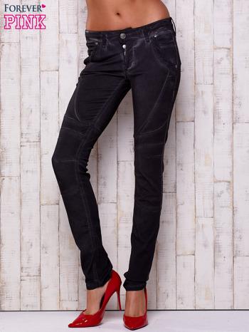 Czarne dekatyzowane spodnie z przeszyciami                                  zdj.                                  1