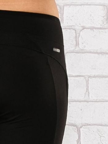 Czarne legginsy 3/4 sportowe termalne z lampasami                                  zdj.                                  6