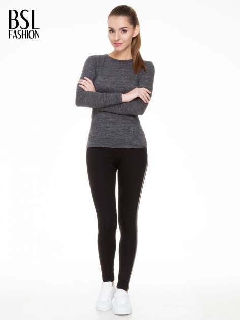 Czarne legginsy z lamapasami ze skóry                                  zdj.                                  2