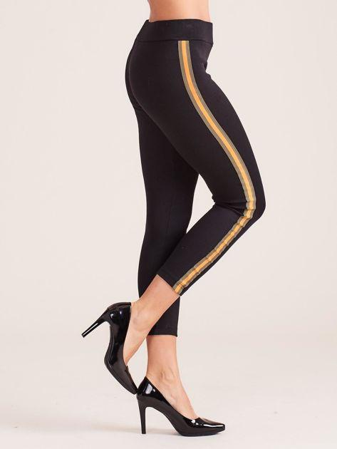 Czarne legginsy z pomarańczowymi lampasami                              zdj.                              1