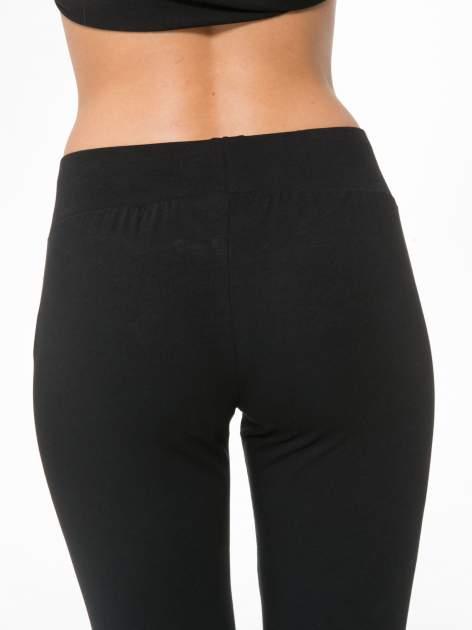 Czarne spodnie dresowe z kieszeniami na zamek                                  zdj.                                  8