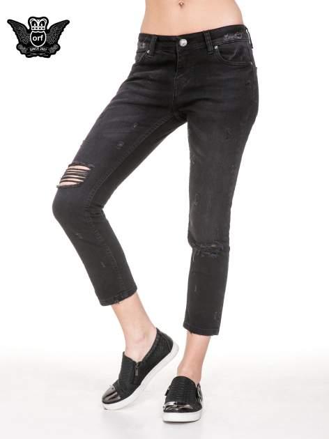 Czarne spodnie jeansowe 7/8 z rozdarciami