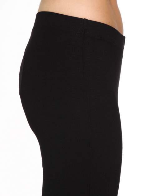 Czarne spodnie typu dzwony                                  zdj.                                  6