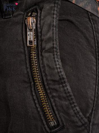 Czarne spodnie typu rurki z suwakami wzdłuż nogawek i z przodu                                  zdj.                                  4
