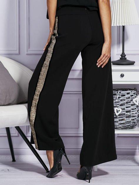 Czarne spodnie z cekinowym lampasem                                  zdj.                                  2