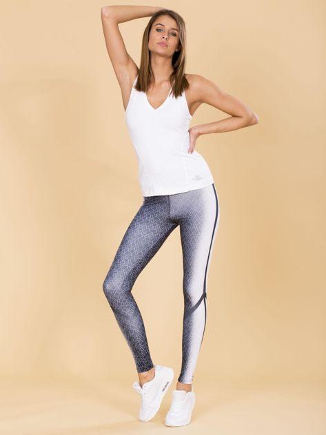 Czarno-białe legginsy w geometryczne wzory                              zdj.                              4