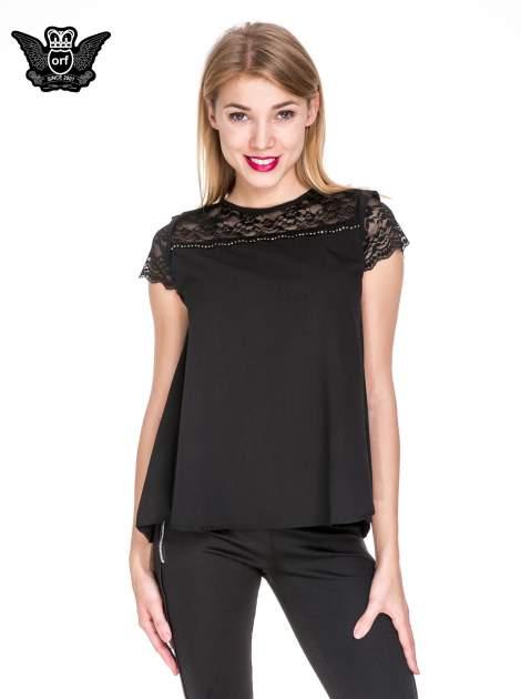 Czarny elegancki t-shirt z koronkową górą o kroju dzownka