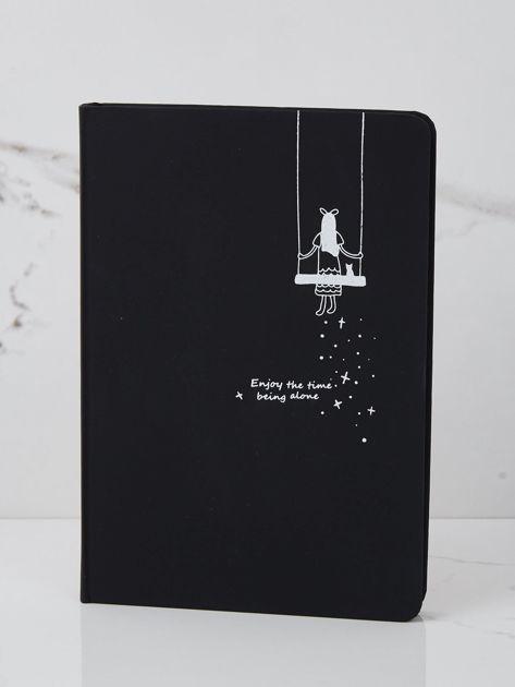 Czarny notes z rysunkowym nadrukiem
