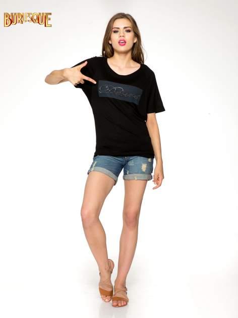Czarny t-shirt z napisem DÉSIRÉ z dżetami