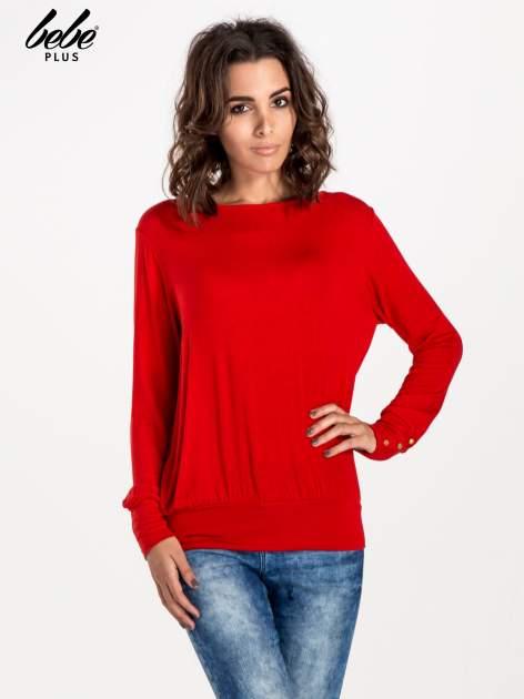 Czerwony sweter z kokardą na plecach                                  zdj.                                  1