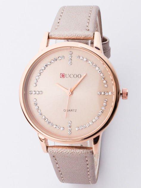 Elegancki perłowo-złoty zegarek damski z cyrkoniami wokół tarczy