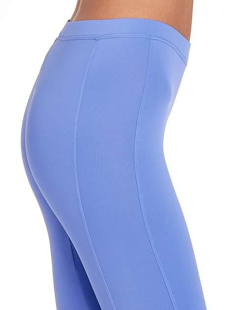 Fioletowe legginsy sportowe termalne z drapowaniem                                  zdj.                                  5