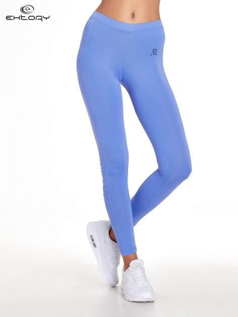 Fioletowe legginsy sportowe termalne z drapowaniem                                  zdj.                                  1