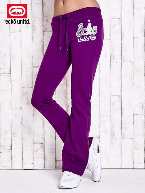 Fioletowe spodnie dresowe z brokatową naszywką