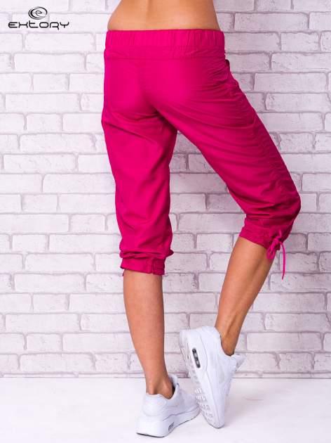 Fioletowe spodnie sportowe capri z guzikami                                  zdj.                                  2
