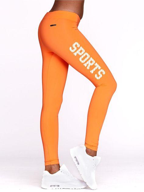 Fluo pomarańczowe legginsy do fitnessu ze sportowym nadrukiem                                  zdj.                                  1