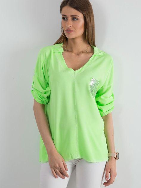 Fluo zielona bluzka damska z cekinową kieszenią