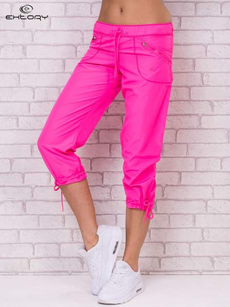 Fluozielone spodnie sportowe capri z wiązaniem                                  zdj.                                  3