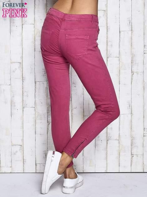 Fuksjowe spodnie z suwakami na nogawkach