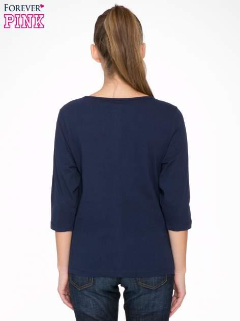 Granatowa bluzka z napisem FOLLOW YOUR DREAMS                                  zdj.                                  4