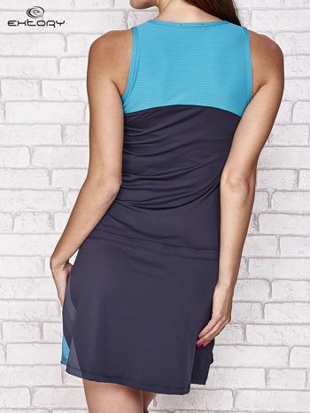 Granatowa sukienka sportowa z niebieskimi wstawkami                                  zdj.                                  4