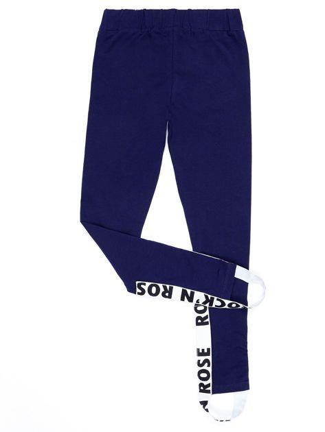 Granatowe legginsy dla dziewczynki z napisami                              zdj.                              7