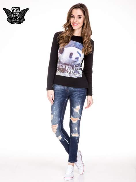 Granatowe spodnie jeansowe rurki z poszarpanymi nogawkami                                  zdj.                                  2