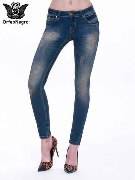 Granatowe spodnie skinny jeans z cieniowaniem i przetarciami