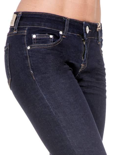 Granatowe spodnie super skinny jeans długości 7/8                                  zdj.                                  6
