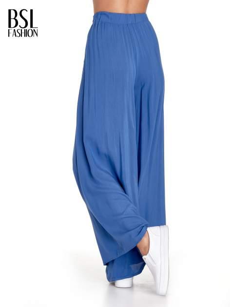 Granatowe zwiewne spodnie typu culottes                                  zdj.                                  4