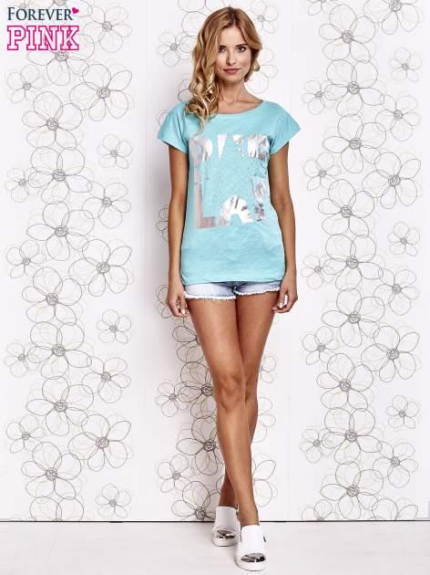 Jasnokoralowy t-shirt z motywem gwiazdy i dżetami                                  zdj.                                  4