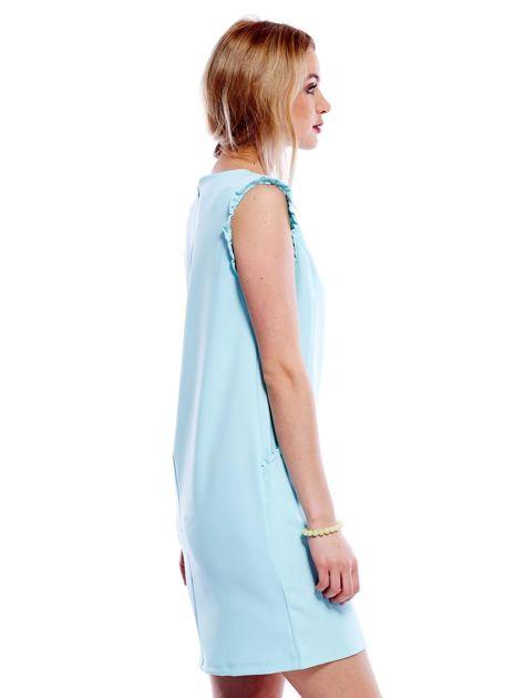 Jasnomiętowa sukienka z drobnymi falbankami                              zdj.                              3