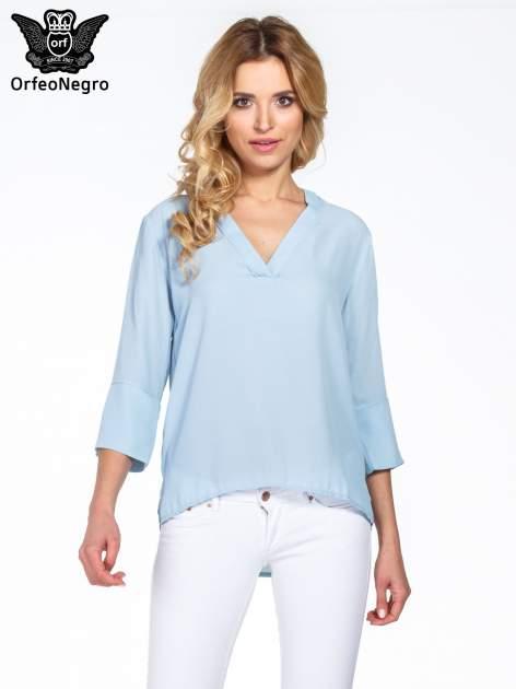 Jasnoniebieska koszula z dłuższym tyłem i rękawkami 3/4                                  zdj.                                  1