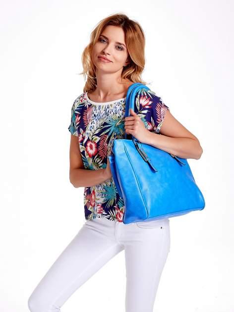Jasnoniebieska miejska torba z ozdobnymi klamrami                                  zdj.                                  2