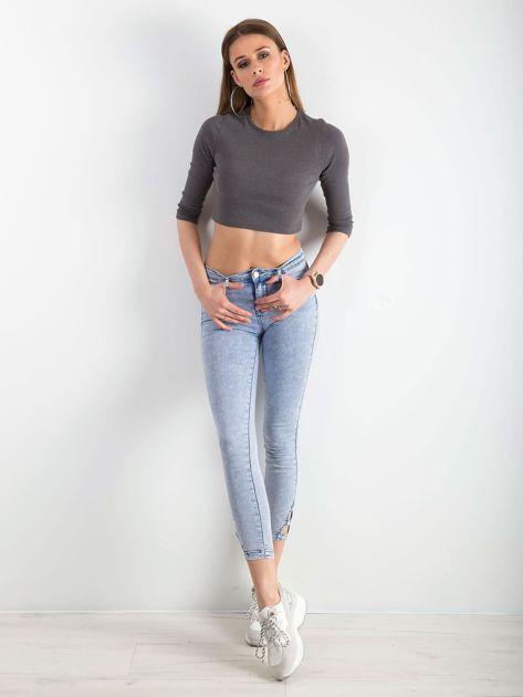Jasnoniebieskie jeansy skinny z wycięciami                              zdj.                              4