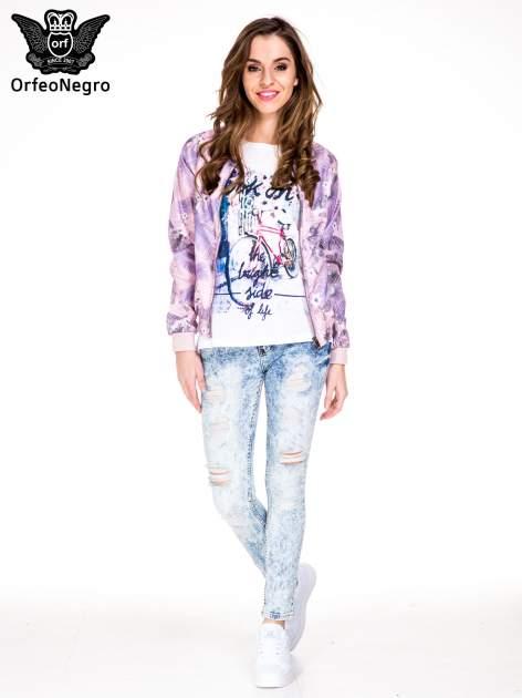 Jasnoniebieskie marmurkowe spodnie jeansowe rurki z dziurami i przetarciami                                  zdj.                                  2