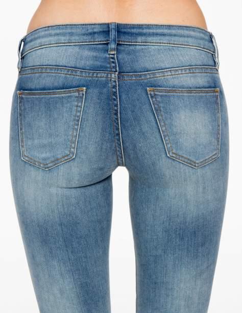 Jasnoniebieskie rozjaśniane spodnie jeansowe rurki                                   zdj.                                  6