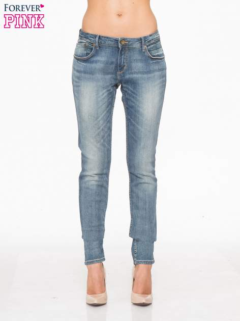 Jasnoniebieskie spodnie jeansowe rurki z cieniowaniem                                  zdj.                                  1