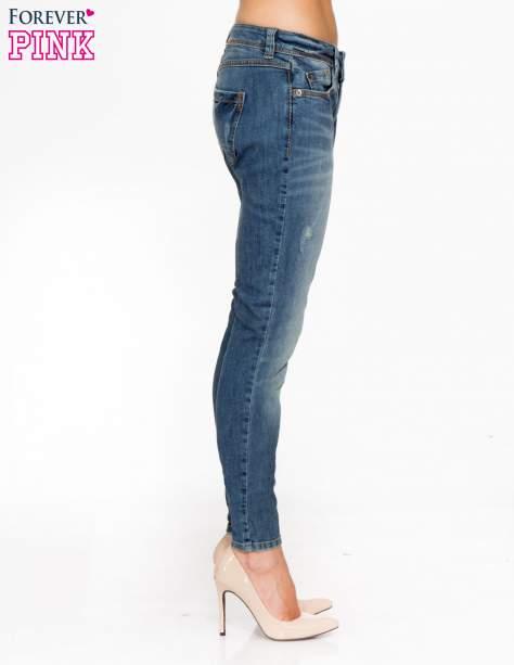 Jasnoniebieskie spodnie jeansowe typu rurki z cieniowaniem                                  zdj.                                  3