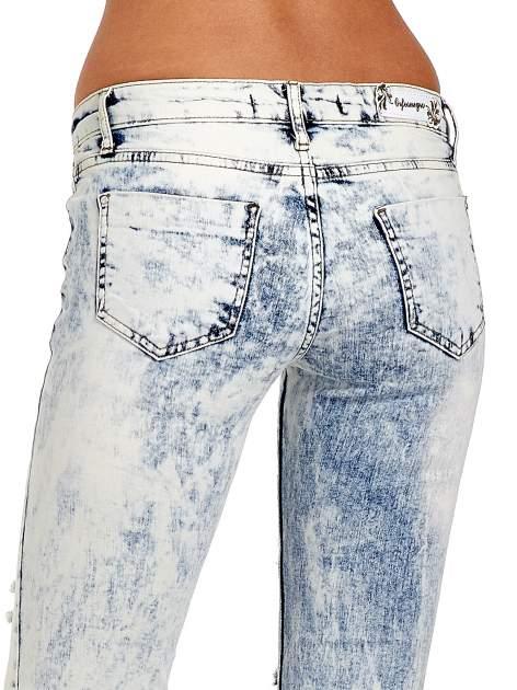 Jasnoniebieskie spodnie jeasnowe dzwony cut out                                  zdj.                                  7