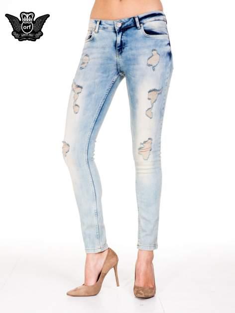 Jasnoniebieskie spodnie skinny jeans z przetarciami                                  zdj.                                  1