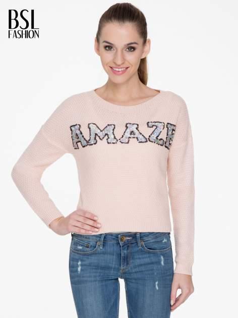 Jasnoróżowy sweter z napisem AMAZE z cekinów                                  zdj.                                  1