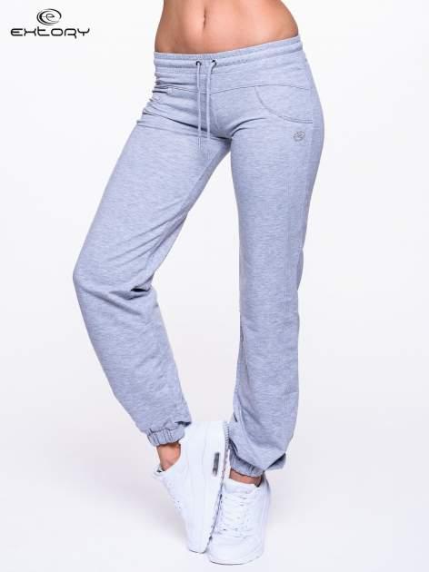 Jasnoszare spodnie dresowe ze ściągaczami