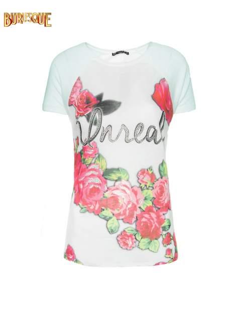 Jasnozielony t-shirt z kwiatowym nadrukiem i napisem UNREAL