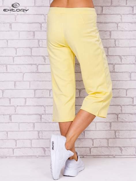 Jasnożółte spodnie sportowe capri                                  zdj.                                  3