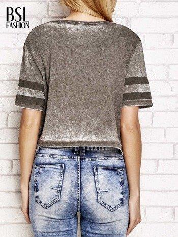 Khaki t-shirt acid wash z literą A